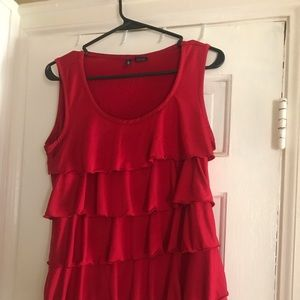 Red sleeveless blouse with ruffles on front